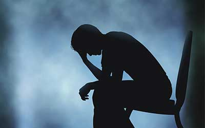 Silhouette of man in depression