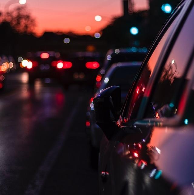 photo of vehicle on asphalt ro