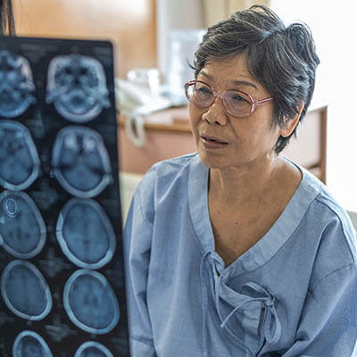 Brain Disease Diagnosis With Medical Doctor Diagnosing Elderly A