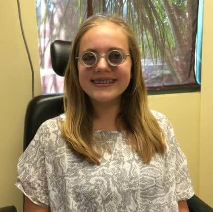 girl wearing full diameter glasses 500