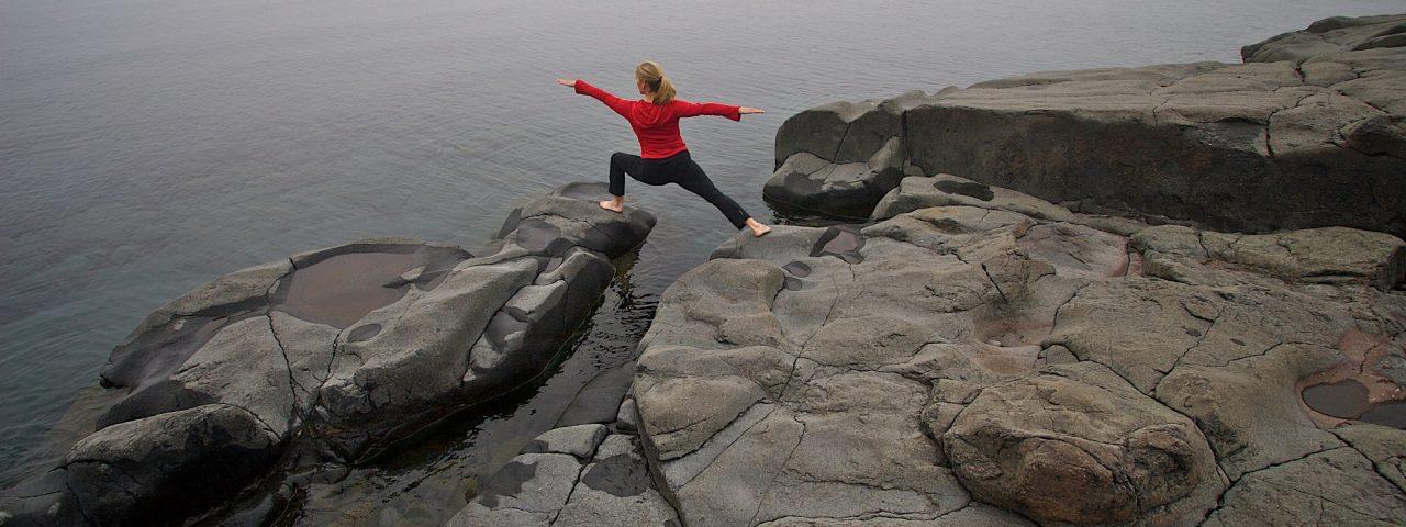 Yoga on rocks by beach