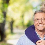 Man wearing eyeglasses, with woman