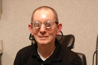 man wearing low vision glasses
