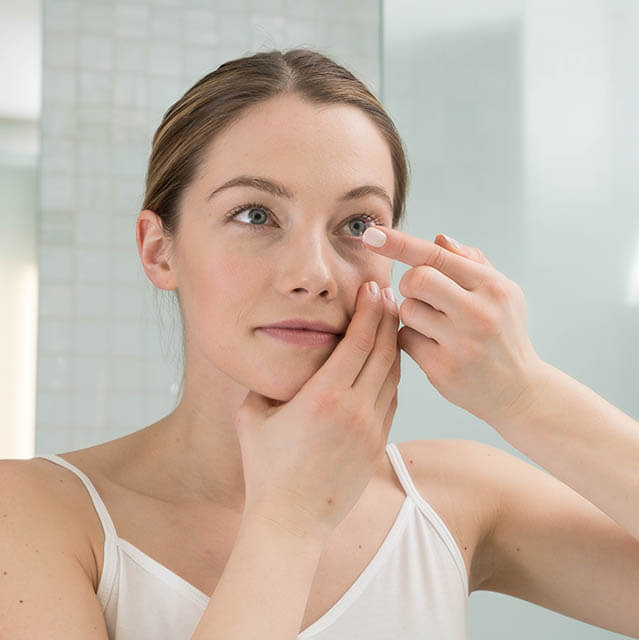 Girl Fitting Contact Lens