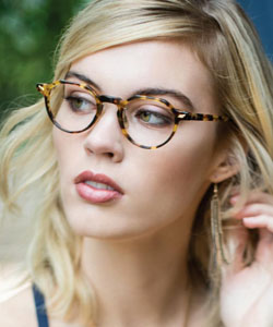 Eye exam, Model wearing Seraphin eyeglasses in Independence, Sandusky, OH