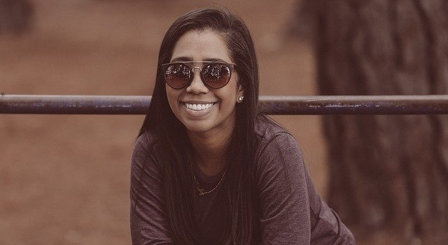 happy woman wearing sunglasses 640.jpg