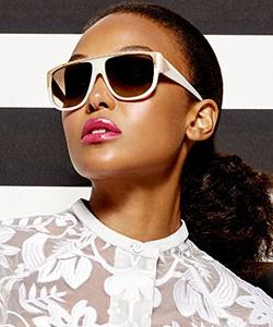 Model wearing LAMB sunglasses