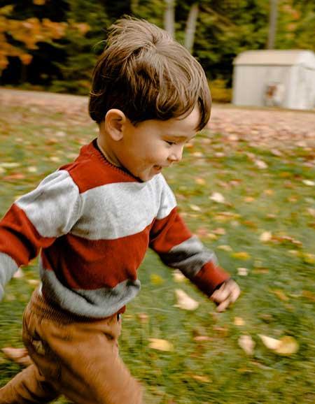 kid running in the garden