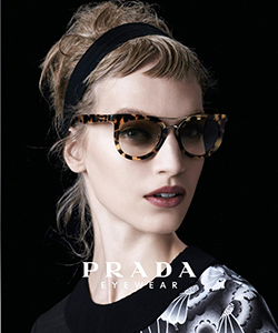 Model wearing Prada glasses