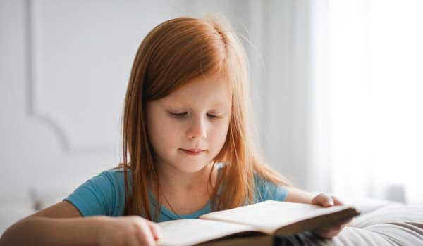 girl in blue t shirt reading book 3755619