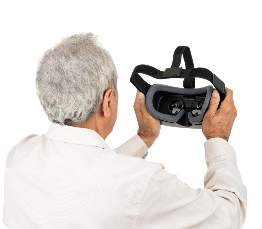 Older Man Looking at Inside of IrisVision