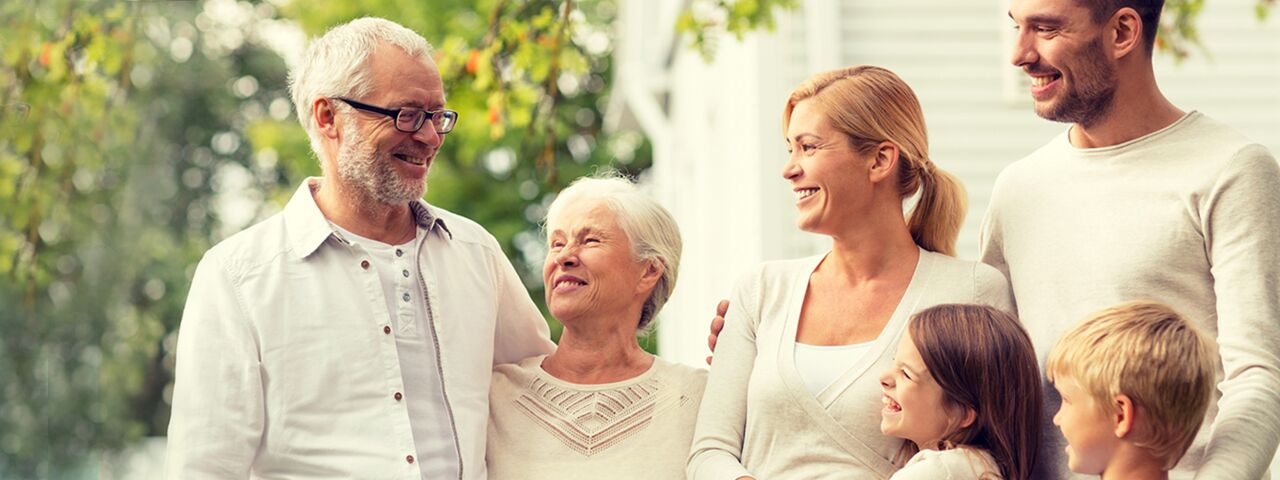 Whole family, including grandfather with eyeglasses
