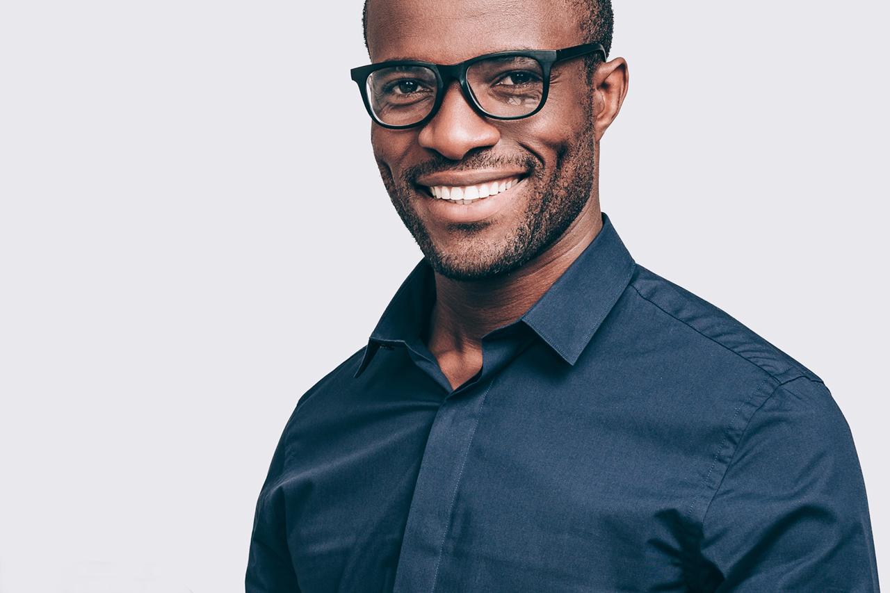 Man Smiling Black Glasses 1280x853
