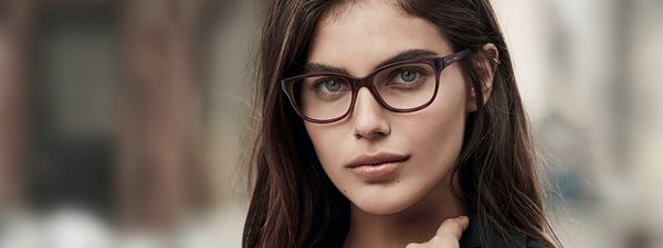 Eye doctor, woman wearing Armani Exchange eyeglasses in St. Pauls and Fayetteville, NC