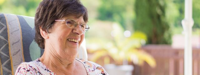 Optometrist, elderly woman wearing glasses in St. Pauls and Fayetteville, NC