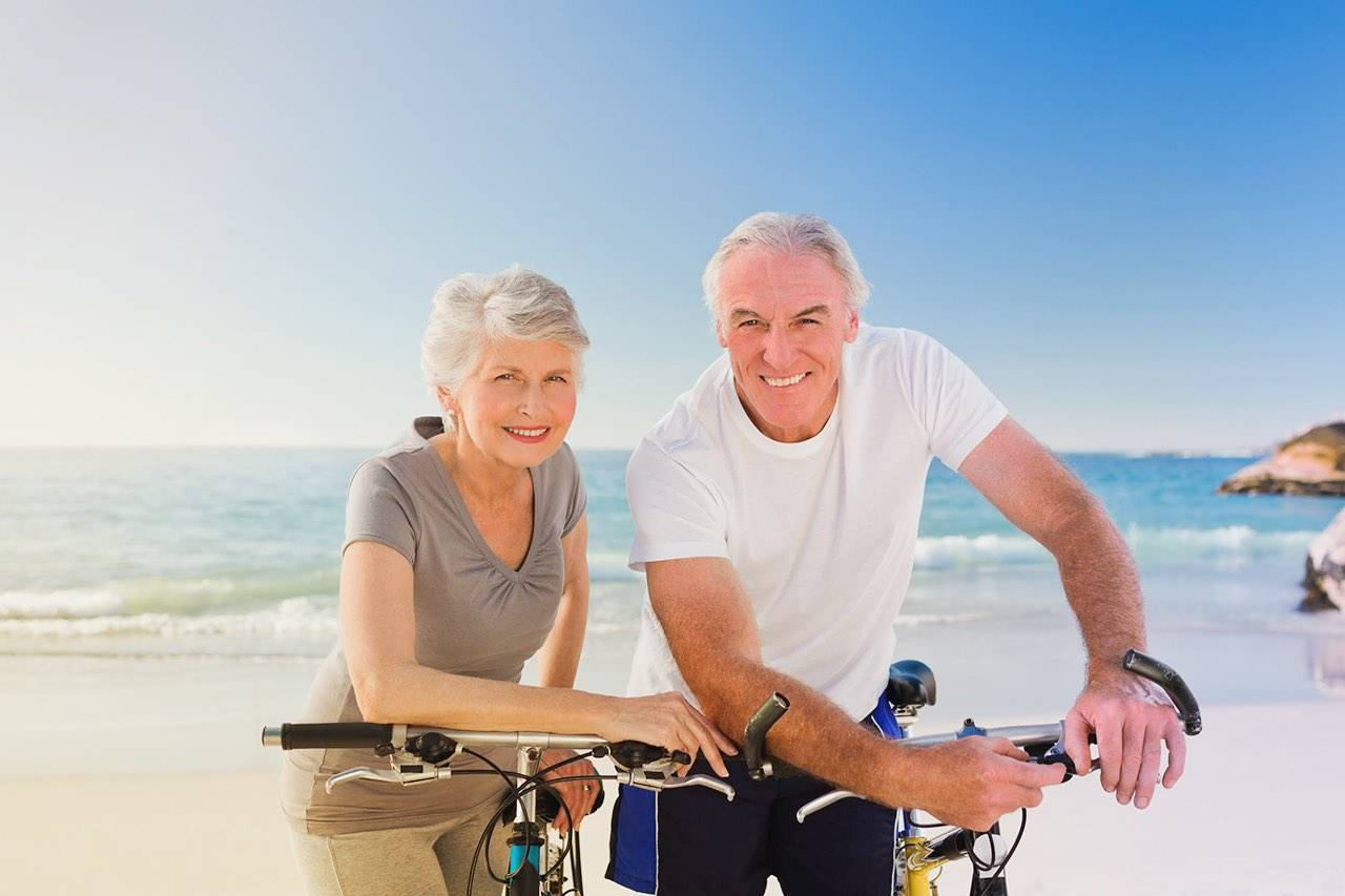 Senior couple beach bicycle 1280×853