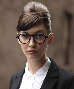 Model wearing Oliver Peoples eyeglasses
