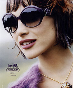 Model wearing Coach sunglasses