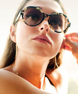 Model wearing Oliver Peoples sunglasses