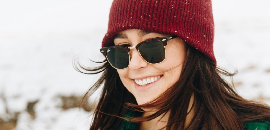 girl wearing sunglasses in winter