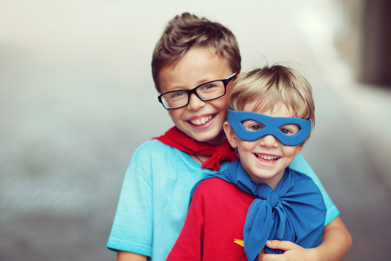 boys dressed as superheroes