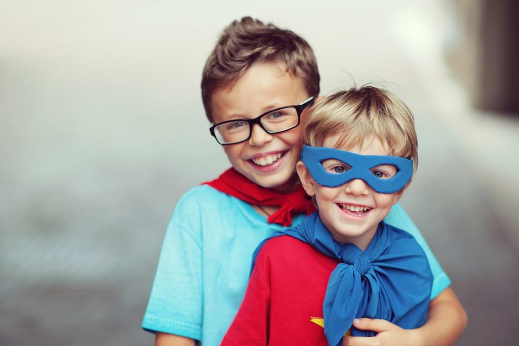 boys dressed as superheroes