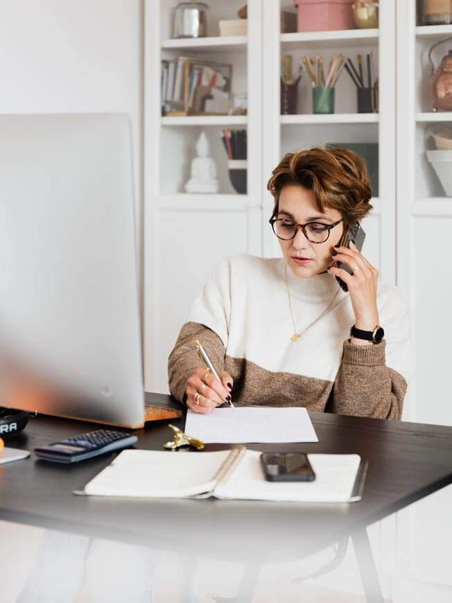 woman making appointment on phone4