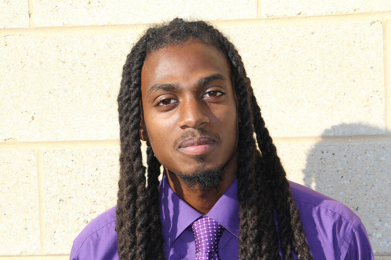Man Purple Shirt Wall 1280×853