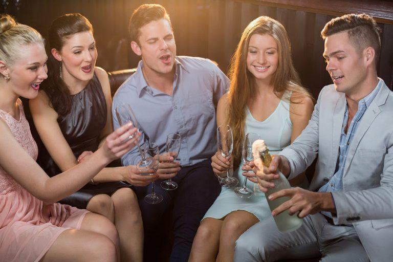 bigstock Man popping a champagne bottle 153750749 768×512
