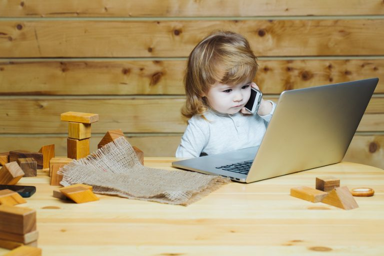 bigstock Small Boy With Computer And Ph 124022261 768×512