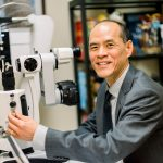 Dr. Nozaki with slit lamp
