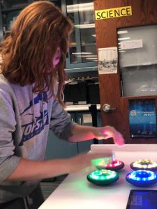 Dr. Lisa Hanna research - teenager pressing colored discs