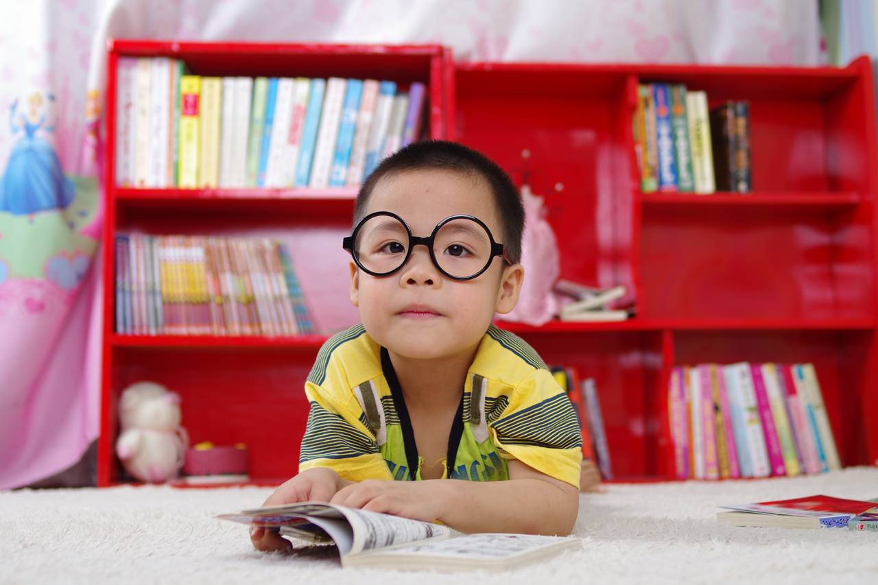 boy glasses red bookcase 1280×853