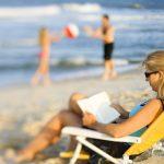 beach woman reading blurred 1280×853
