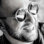 happy man mirrored sunglasses