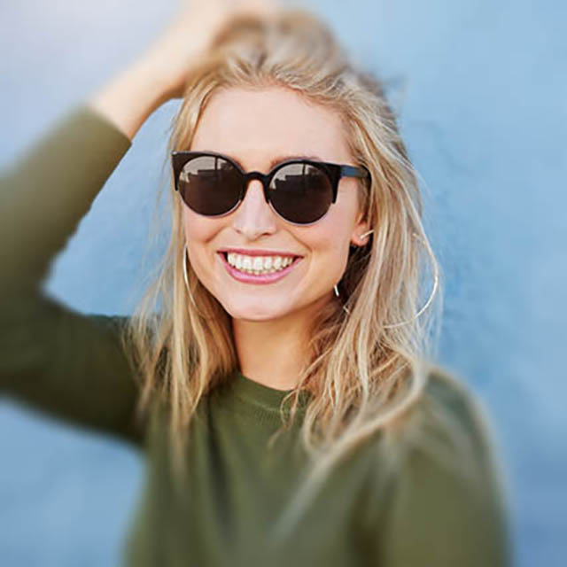 woman wearing designer sunglasses in Great Neck and Plainview, New York