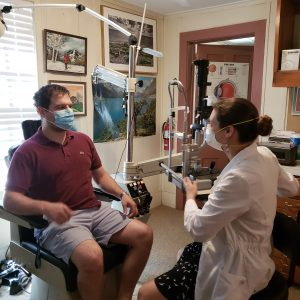 Eye care patient and optometrist both wearing masks in Ithaca, New York