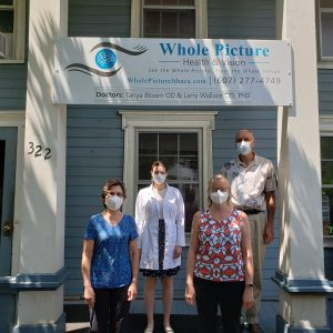 Our eye care staff in front of our optometry clinic in Ithaca, New York
