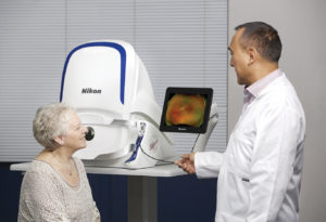Doctor and patient in front of Optos