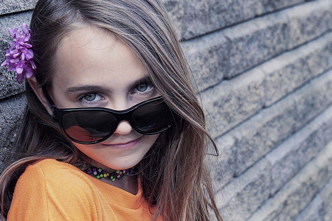 Girl wearing sunglasses after orthokeratology