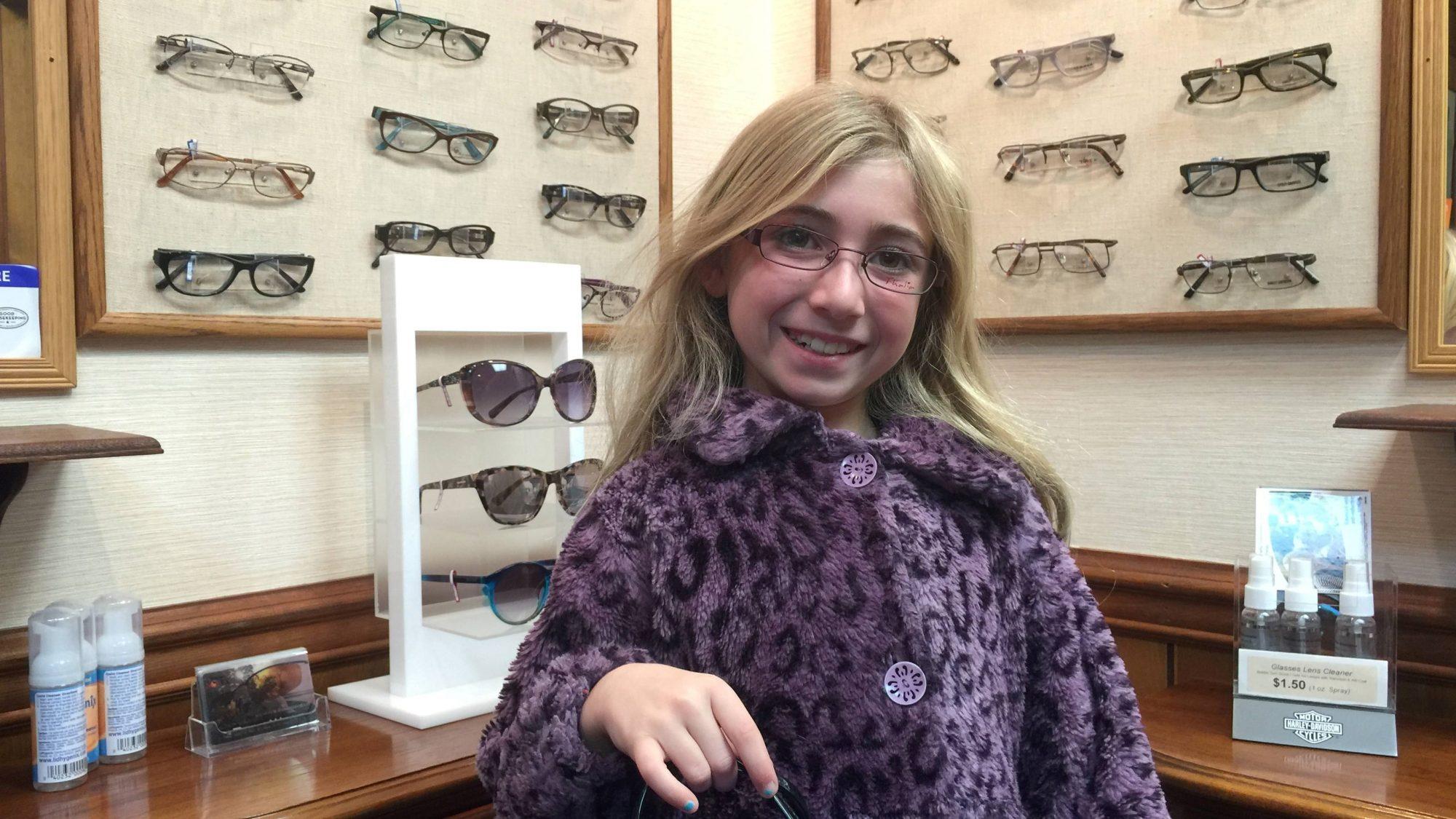 young-girl-glasses-purple-coat-e1517001990241