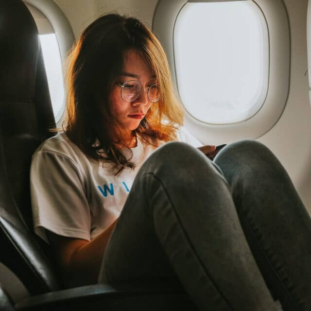 girl on cellphone in airplane e1606056109428.jpeg