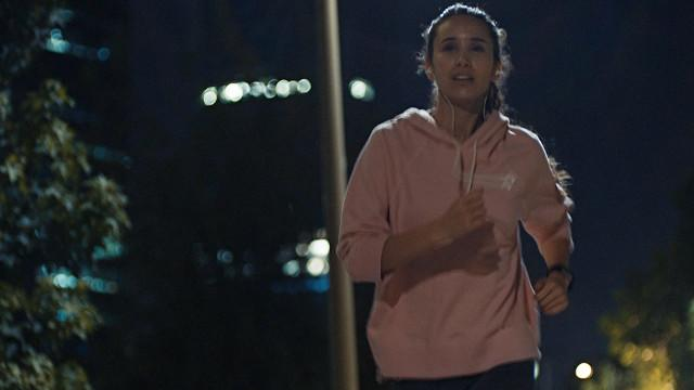 Eye care, girl is jogging at night with contact lens in Longview, TX