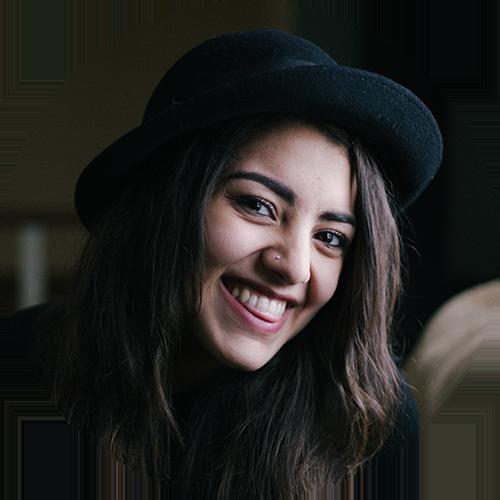 smile-woman-dark-hat-bkgnd.png