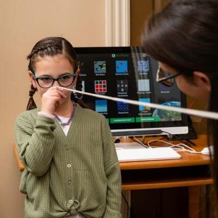 child doing vision therapy