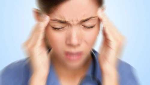 woman with vertigo and headache