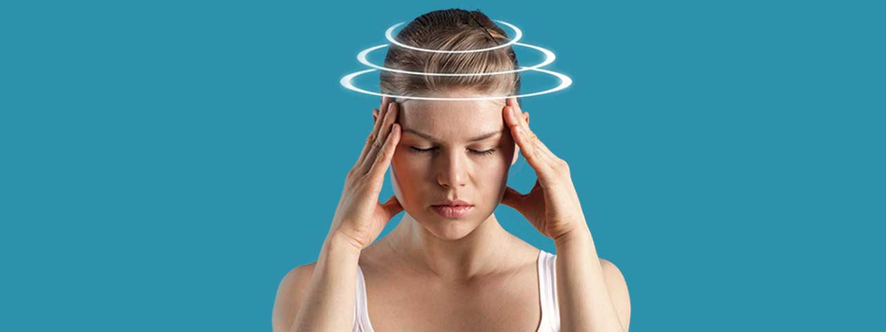 Woman dealing with dizziness and headaches