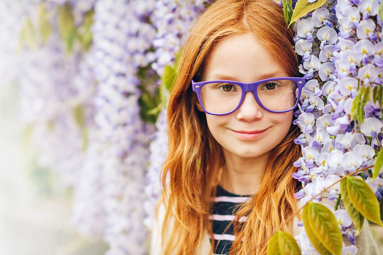 girl in purple glasses for vision therapy