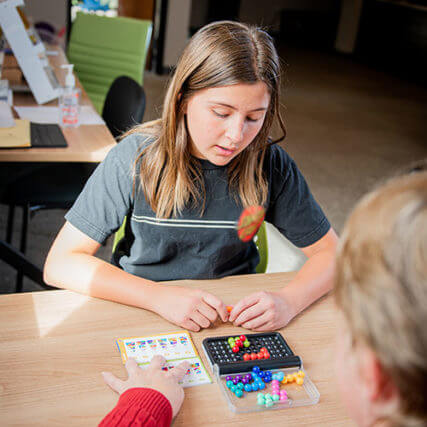 young girl doing vision therapy in Colorado