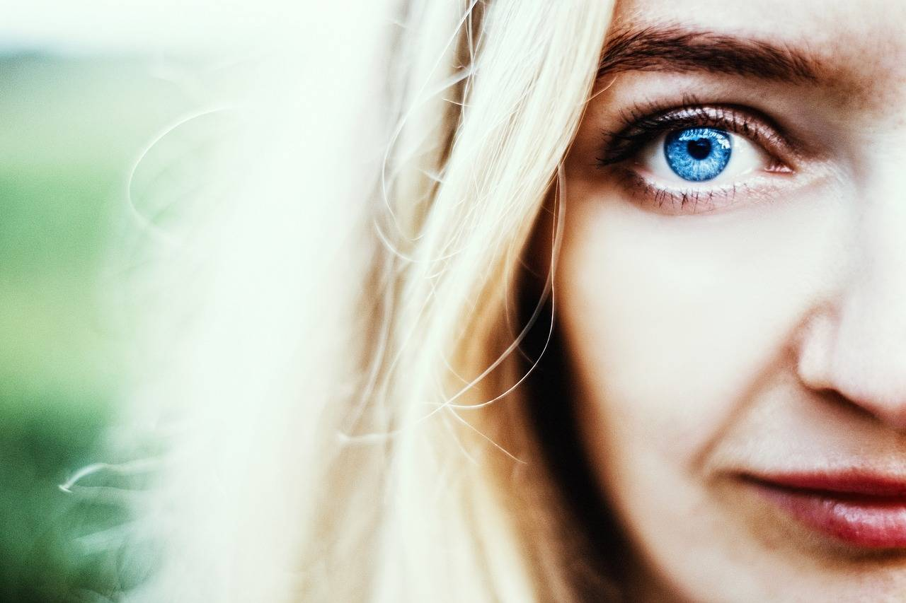 close up of woman with blue eyes, wearing scleral lenses